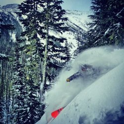 Matty Richard tucks into a Blackcomb pow barrel.